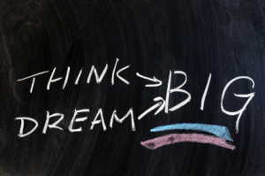 Think and dream big words written on chalkboard